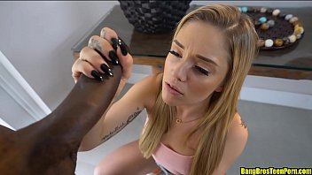 Young petite blonde sucking a huge black cock