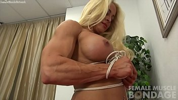 Woman tied up naked Naked female bodybuilder struggles in rope