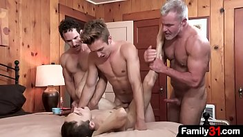 Chiseled step grandpa, pervert stepdad and strapping stepbrother surround the young boy with their stiff dicks and moan as he kisses each of their red hot cocks