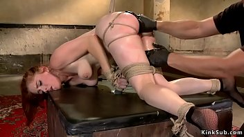 Redhead gets ass whipped on hogtie