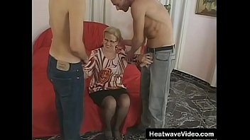 GILF with glasses fucked by men half her age
