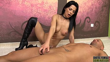 Nude Mistress in knee high boots giving a handjob