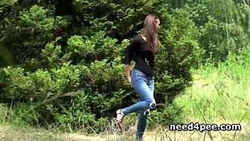 Girl needs a pee Skinny teen pissing behind a wall outdoor