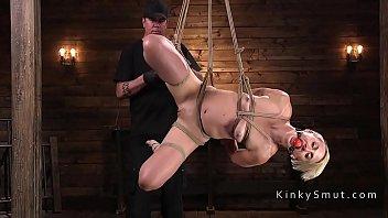 Blonde in extreme rope bondage suspension