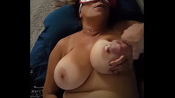 Check out my wife. Cum on her tit. Masked.