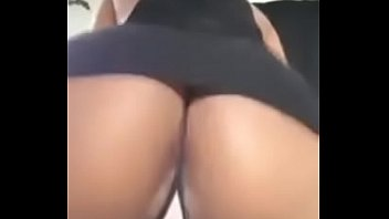 Dancing in a funky dress and showing her panties