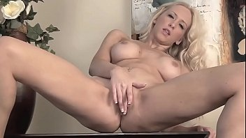 Naughty blond rubs her pussy to a happy end