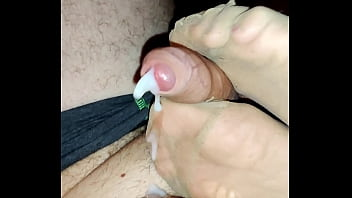 footjob with smelly nylons and a big sea of cum