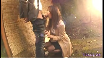 Asian Girl On Her Knees Giving Blowjob Cum To Mouth Spitting To Palm Outside In