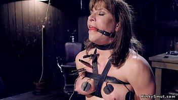 Busty gagged babe in bondage toyed