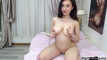Natural busty Asian camgirl posing
