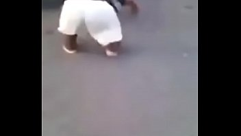 Angry wild black dwarf to eat the curious ass