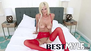 Tall and tempting blonde MILF Olivia Blu loves showing off her body and her sexy red lingerie, so she has her man film her as she struts her stuff in high black stilettos.