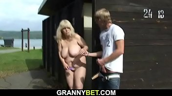 Stranger fucks busty blonde granny on public