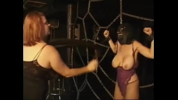 Redhead BBW with huge tits puts a closed mask on her slave&#039_s face and fondles her nipples hard
