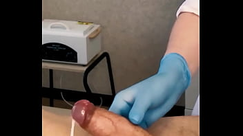 The Patient CUM Powerfully During The Examination Procedure In The Doctor's Hands