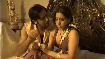 Sizzling Honeymoon Coouple on Bed Hot in Beach