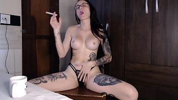 Cris Bathory masturbating while smoking a cigarette