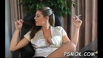 Hawt slut in fishnet nylons teases while smoking