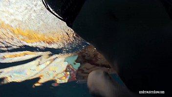 Redheaded Katrin is stripping underwater Vorschaubild