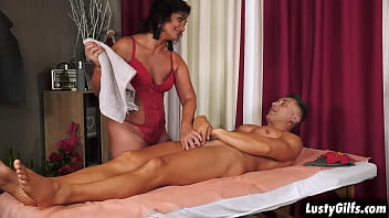 Granny Masseuse Arwen Wears Sexy Red Lingerie, She Started Massaging Her Client's Cock That Gets Bigger Every Time She Strokes It.