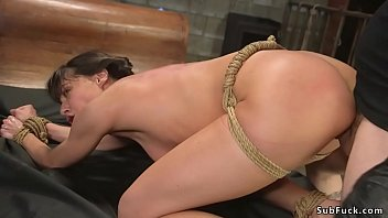 Tied slave is anal fucked by master