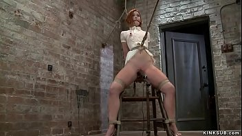 Redhead slave in pink knickers caned