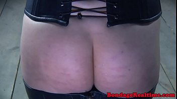 Inked BDSM slaves groping each other