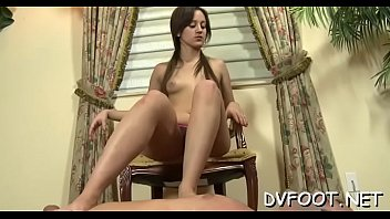 Girl plays with feet on schlong