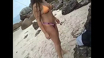 Young latina wife gets naked, dances and teases men on public beach in Brazil - real amateur slut