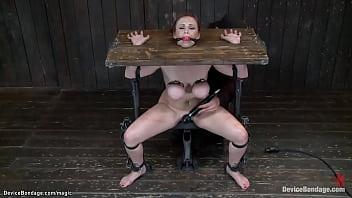 Busty bound MILF sitting on dildo