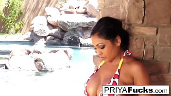Indian MILF  Priya Rai gets all wet outside by the pool