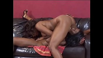 Black lesbian hoe with big hanging boobs straponed by chocolate girlfriend