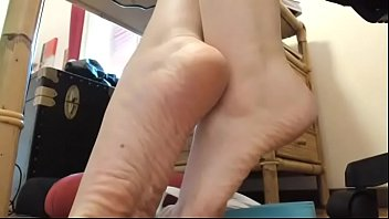 He loves Nicoletta's feet while relaxing at the desk wouldn't you like to lick them all?