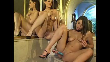 Adorable brunette gets toy fucked by lovely friend in front of mirror