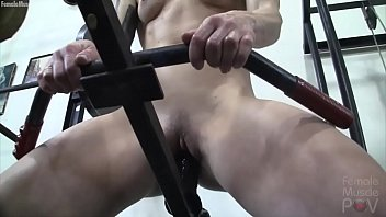 Redhead Female Bodybuilder Masturbates with Gym Equipment