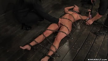 Busty slave whips other bound slave