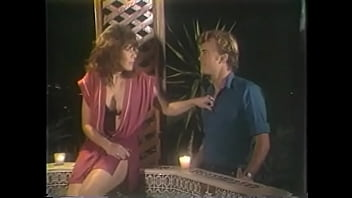 Fellow and pretty barmaid spin a yarn telling each other about the most unusual place they made sex; his story about sex with gorgeous brunette Janey Robbins in outdoor jacuzzi looking out over night city was very impressive