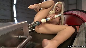 Tanned blonde beauty is machine fucked