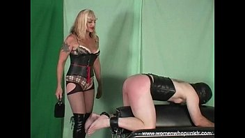 Mistress Kelly spanks and paddles her slave on the spanking horse