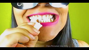 Girl with beautiful teeth crumpled chewed up candy chewing gum nuts to mud chew videos, look her very close in her mouth
