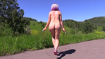 Nudist tit Sexy nudist in a public place jumps on a jump rope outdoors and shakes a big butt. fetish.