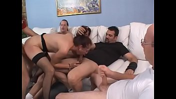 Cock sucking hooker takes double team fucking and facial in gang bang