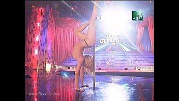 Flexible blonde stripper on stage