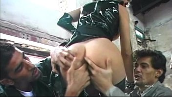 Shaved young slut in latex is banged by two cocks