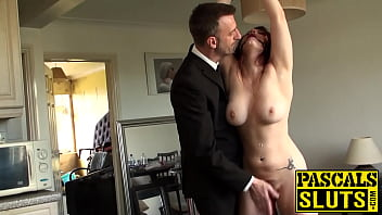 Busty redhead submits to doms torment and anal pounding
