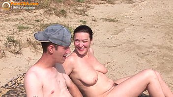Real amateur threesome on the beach thumbnail