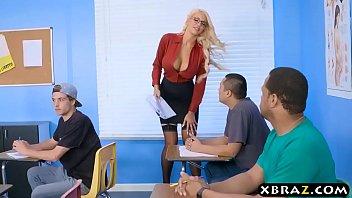 Immens curves teacher blonde fucks her student in class