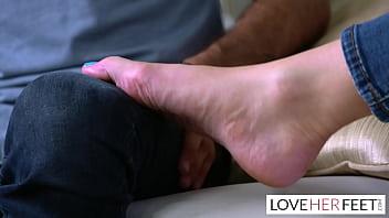 Redhead big titty MILF gives a slippery footjob