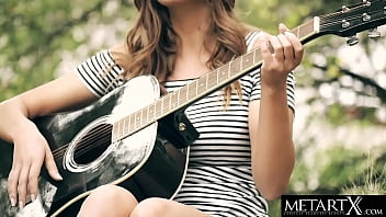 Gorgeous girl with perfect body strums her guitar then her pussy
